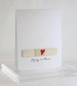 A card with a band aid on the front.