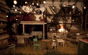 The mostly outdoor bar looks like a lovechild between your Grandma's living room and World War II itself… in a good way.