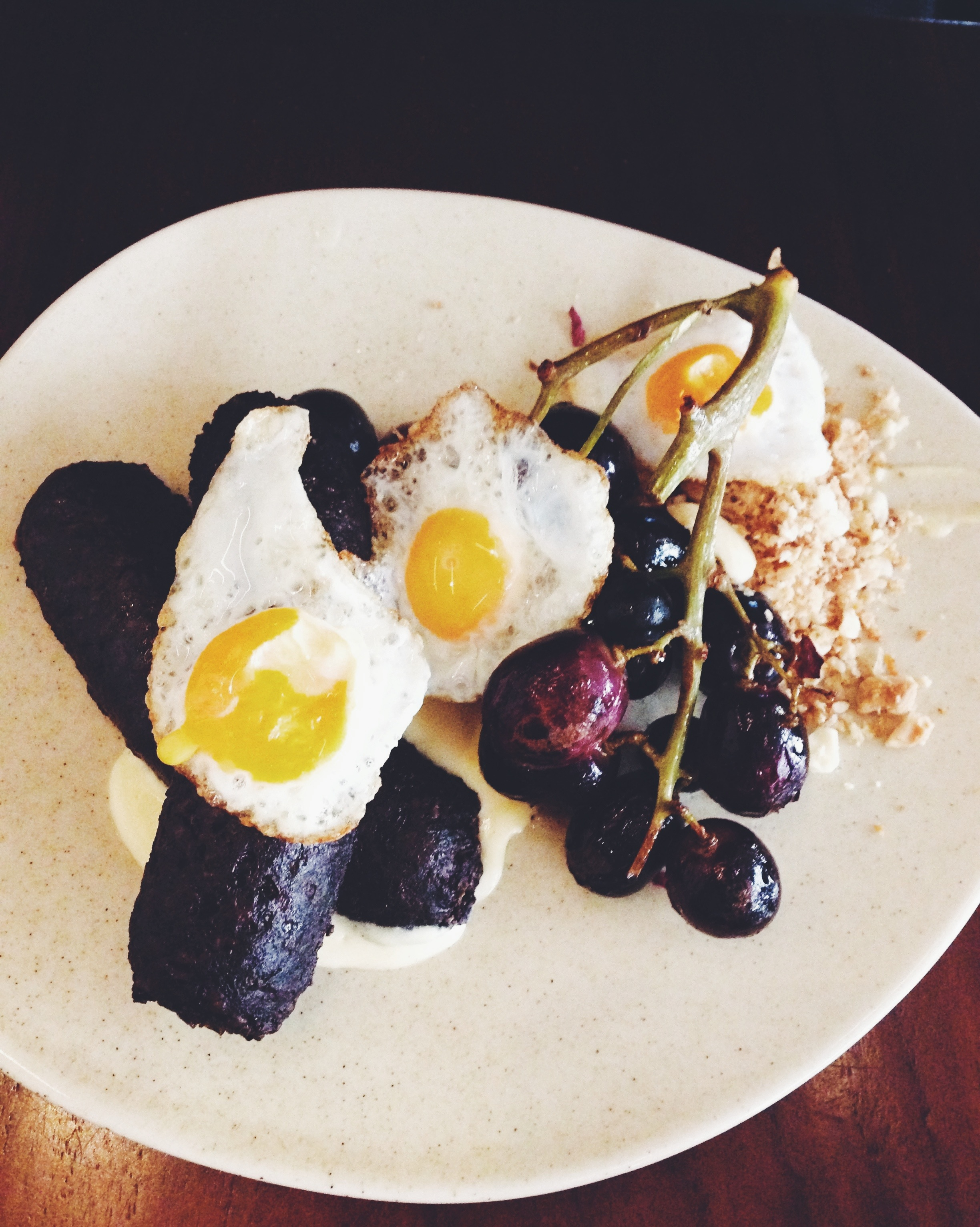 Black pudding, fried quail eggs, manchego custard, flamed currants, smoked almonds $19